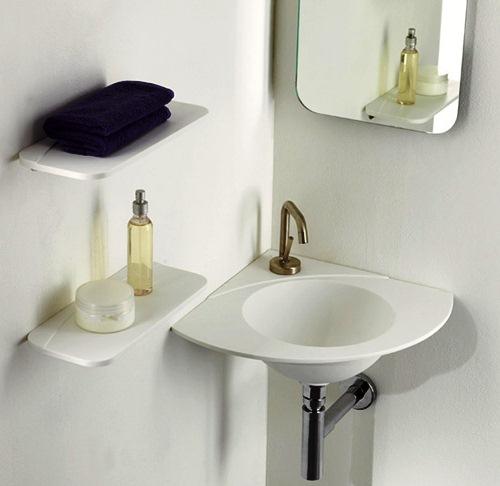 Значно розширить простір кутова раковина. Кран для раковини можна зробити вбудованим в стіну або вибрати для встановлення спеціальну міні-сантехніку.