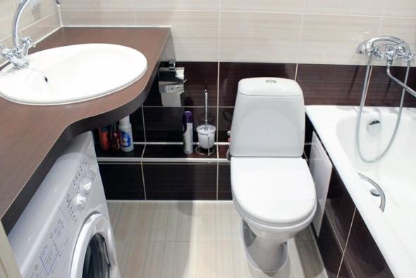 Під раковиною може розташуватися пральна машина або стільниця з безліччю поличок або ящиків для рушників.